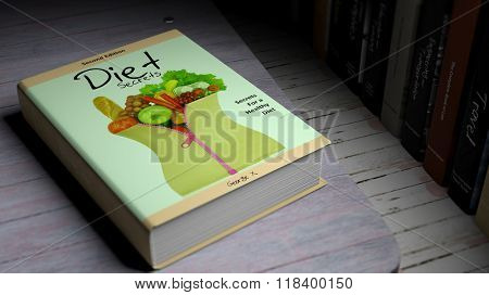 Hardcover book on Diet with illustration on cover, on wooden surface.