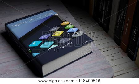 Hardcover book on Computers and Technology with illustration on cover, on wooden surface.