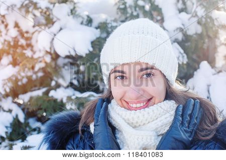 Happy Woman In White Knitted Hat In Winter