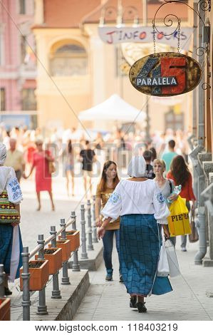 Woman Wearing Traditional Romanian Clothes On Street
