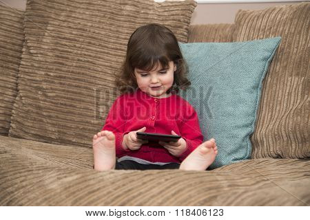 Young girl learning on her tablet PC