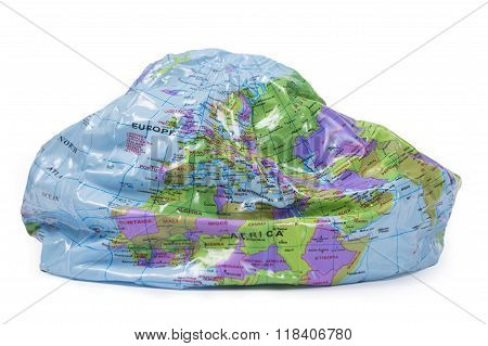 partly deflated inflatable globe - gloabal warming concept