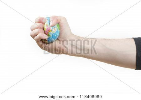Global warming issues concept, male hand gripping world globe