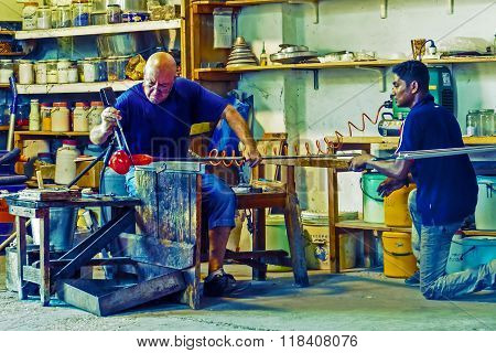 Glassworker In Action In The Murano Glassfactory 8