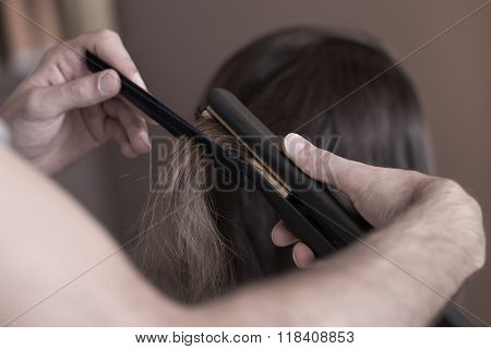 Hairdresser Using A Hair Straightener