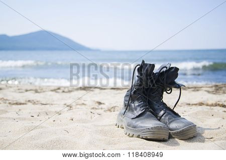 Old boots rest on the beach