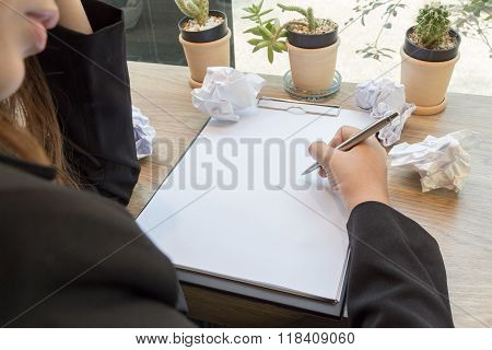 Woman Hand Write In Notebook With Pen And Paper Balls