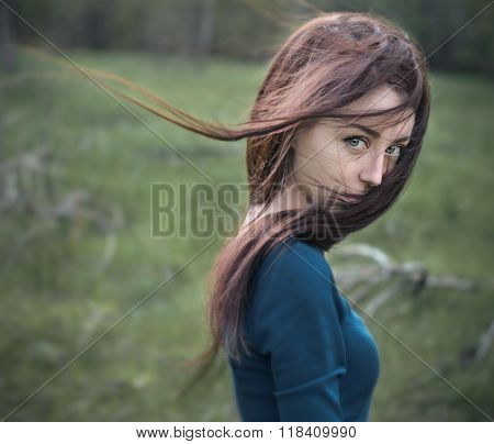 Dramatic Portrait Of A Girl Theme: Portrait Of A Beautiful Girl With Flying Hair In The Wind In The