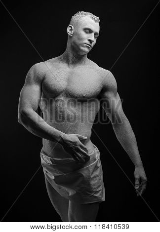 Statue And Makeup Body Topic: Inflated Man With Big Muscles Painted In White Paint Is Cracked On A D