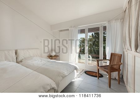 Interior of house, double bed with comfy duvets