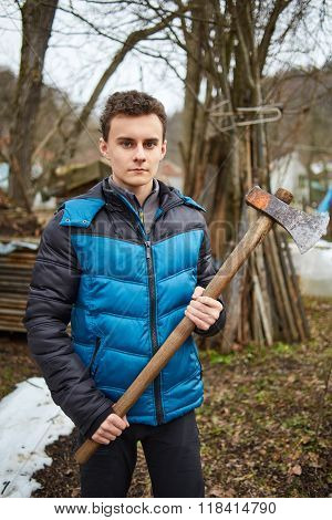 Teenager Holding Axes Outdoor