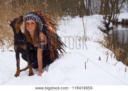 Girl In Headdress With Dog