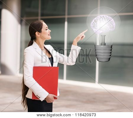Business woman point on the big light bulb
