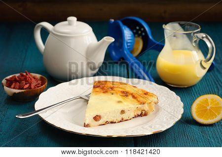 Homemade Cottage Cheese Cheesecake With Raisins, Lemon Curd, Tea And Goji Berries