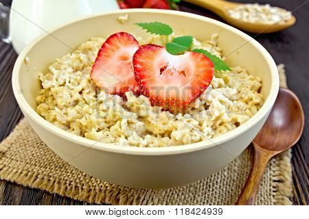 Oatmeal with strawberries on sacking