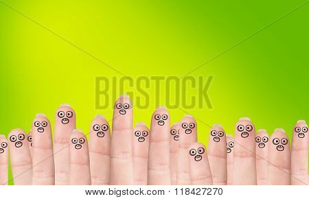 Many fingers with drawn faces