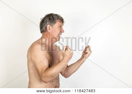 Naked Man With Agressions Shows Shadow Boxing