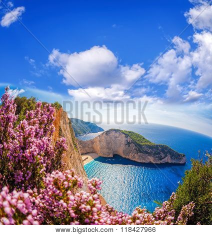 Navagio Beach With Shipwreck And Flowers Against Blue Sky On Zakynthos Island, Greece