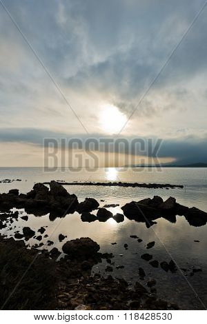 Sunset on a beach at Nora archeological site, near city of Pula, island of Sardinia