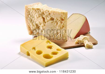 Three Slices Of Cheese On Cutting Board