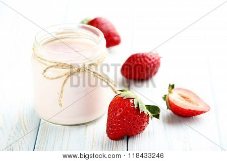 Strawberry Yogurt In Glass On A Blue Wooden Table