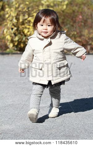 Japanese girl taking a walk in the park (1 year old)