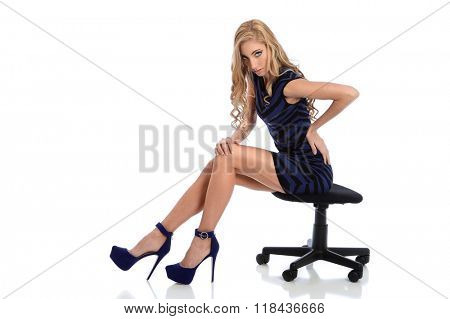 Portrait of beautiful young woman seating isolated over white background