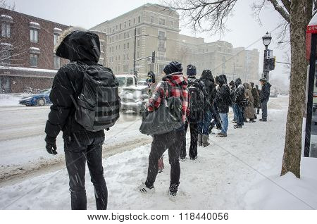 People waiting for bus on bus stop in Montreal