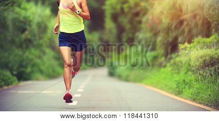 young fitness woman runner running on road