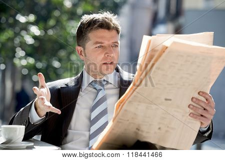Businessman Sitting Outdoors Having Coffee Cup For Breakfast Early Morning Reading Newspaper News Lo