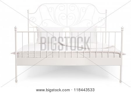 Frontal view of a white bed with a vintage decoration isolated on white background