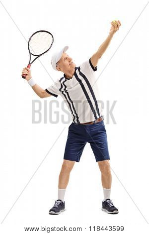 Full length profile shot of a senior tennis player preparing to serve isolated on white background