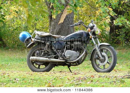 Old Motorcycle Parked Outdoors