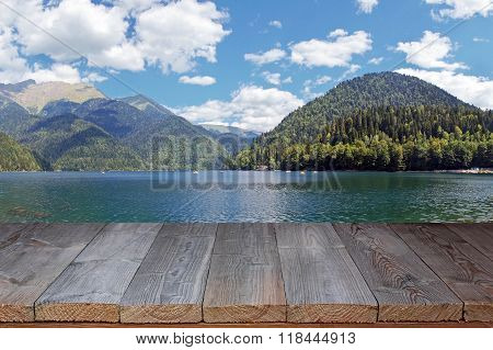 Empty Wooden Flooring Against The Lake In Mountains