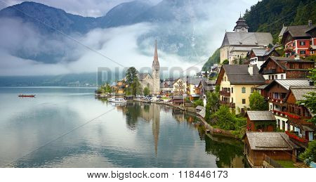 Panorama of Hallstatt mountain village. Foggy morning