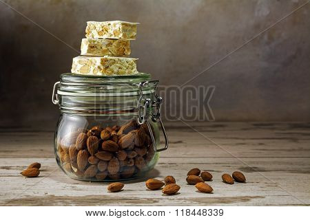 Festive Torrone Or Nougat On A Glass Jar With Almonds On A Rustic Woodn Table