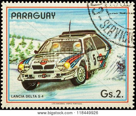 Rally Car Lancia Delta S4 On Postage Stamp