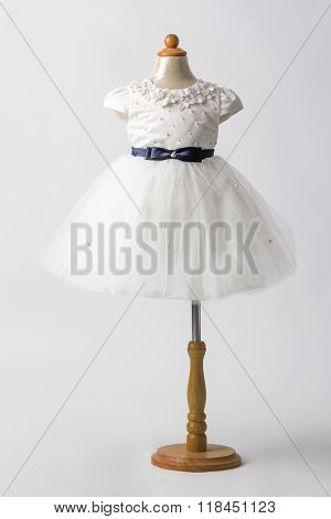 Baby White Dress On A Mannequin