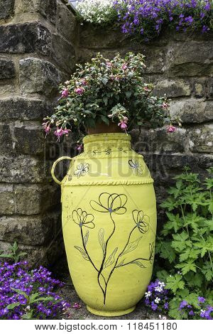 Garden planter with Fuchsia plant.