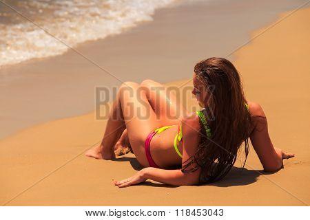 Blonde Girl In Bikini Closeup Backside Lies On Back By Sea