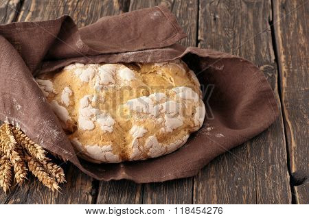 Fresh Loaf Of Homemade Bread Wrapped In Fabric