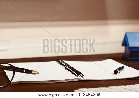Blank Notebook On Wooden Home Office Desk