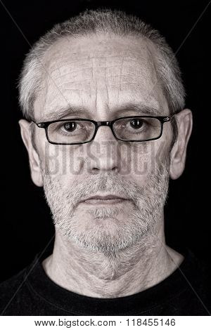 Portrait Of A Serious Man Wearing Glasses