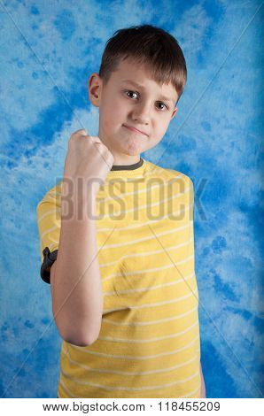 Portrait Of Emotionally Kid. Angry Child Show Fist