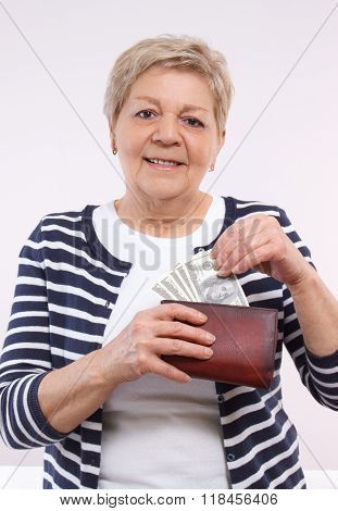 Happy Senior Female Holding Wallet With Currencies Dollar, Concept Of Financial Security In Old Age
