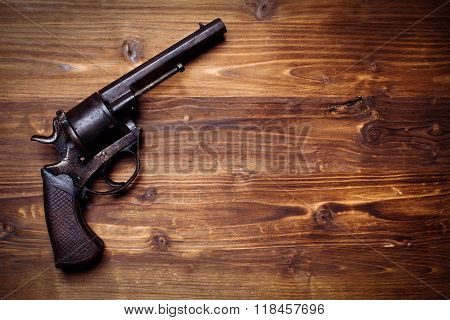 Revolver on the wooden table