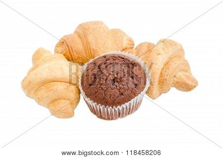 Three Small Croissant And Chocolate Muffin On A Light Background