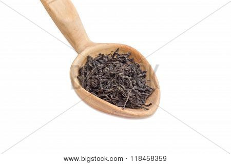 Dried Leaves Of Black Tea In A Wooden Spoon