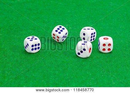 Traditional Plastic Six-sided Dice On Table With Green Cloth