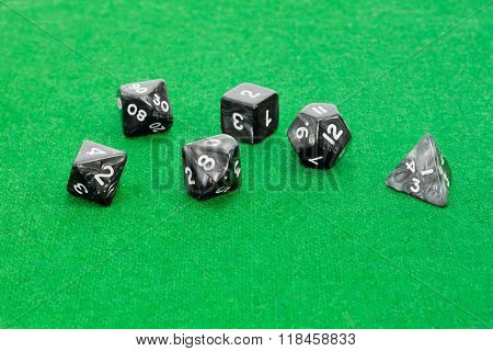 Specialized Polyhedral Dice For Role-playing Games On Green Cloth